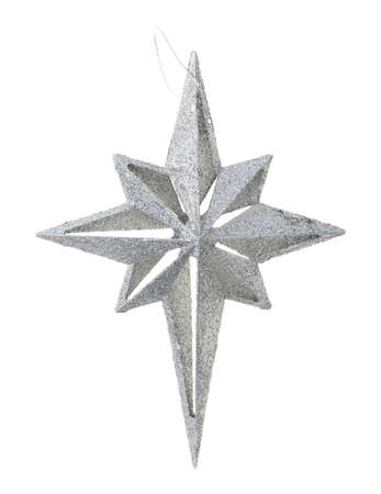 A large plastic star shaped ornament covered with silver glitter isolated on a white background.