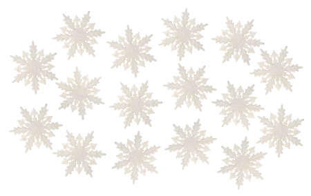 A group of plastic snowflakes with glitter isolated on a white background.