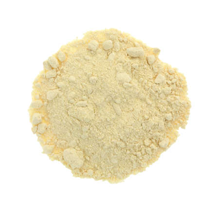 Top view of a portion of soy powder isolated on a white background.