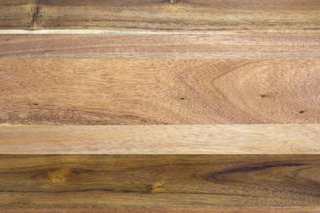hardwoods: Top view of an old wood table top with several types of hardwood glued together.