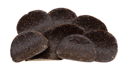 A group of dark chocolate covered rice crisp wafers isolated on a white background. Stock Photo