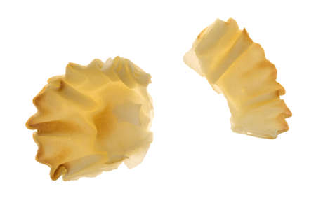 filo pastry: A broken miniature phyllo shell broken isolated on a white background.