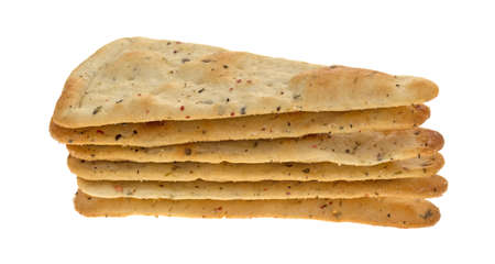 pizza crust: Seasoned pizza crust chips in a stack isolated on a white background. Stock Photo
