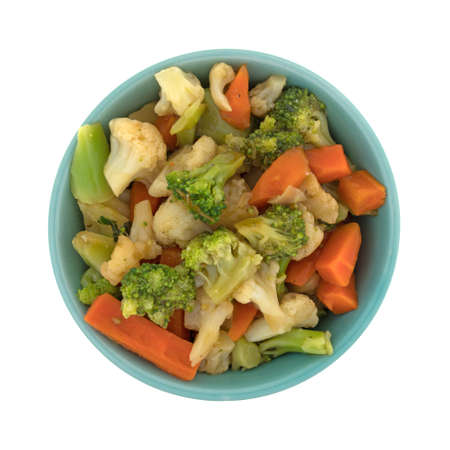 Top view of a bowl filled with carrots, broccoli and cauliflower in a sauce isolated on a white background.