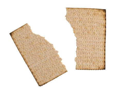 Top view of a single whole wheat matzo cracker that has been broken in half isolated on a white background.