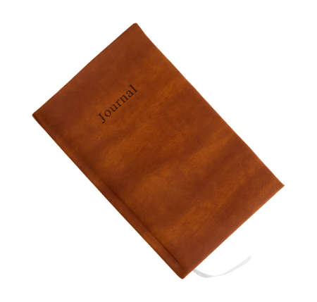 Top view of a brown leather journal isolated on a white background.