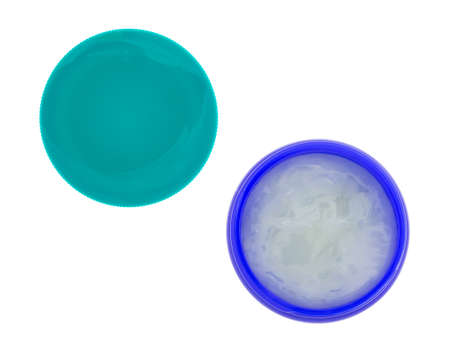 Top view of an opened container of chest rub with a lid to the side isolated on a white background.