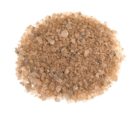 A small pile of sand and salt mixed for deicing and sanding roads in the wintertime isolated on a white background.