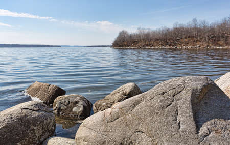 View of shoreline boulders at high tide at Stockton Springs Maine in the late winter.