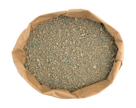 Top view of an opened bag of ground clay cat litter isolated on a white background. Фото со стока