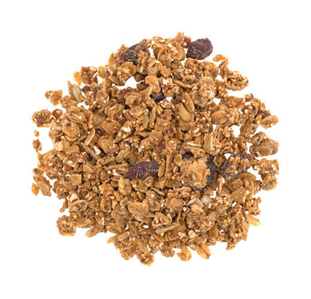 Top view of organic cranberry and nut dry granola cereal isolated on a white background.