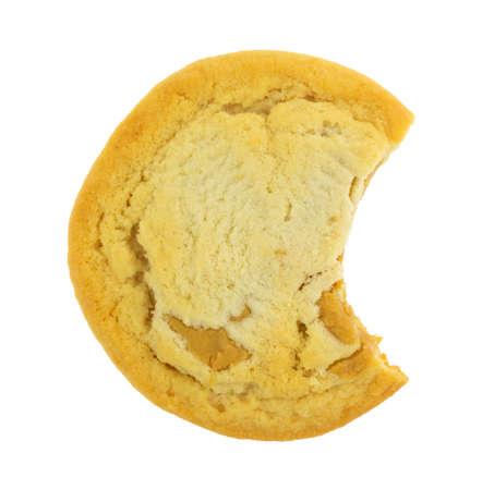 Top view of a bitten chunky peanut butter cookie isolated on a white background.