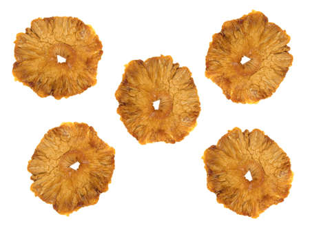 Top view of a group of sun dried pineapple slices isolated on a white background. Banco de Imagens