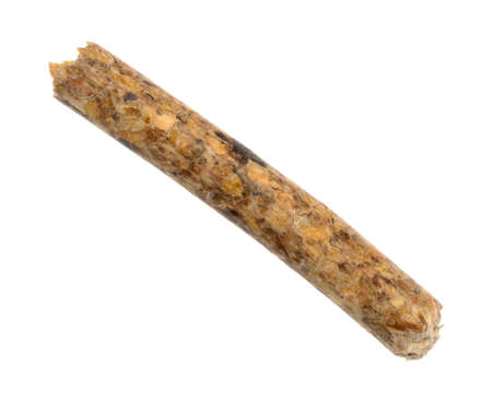 A single wood pellet for heating isolated on a white background.