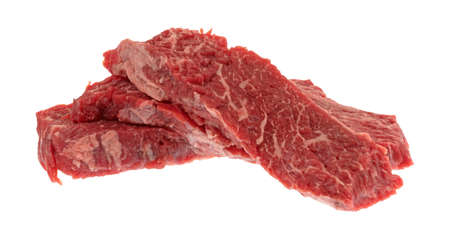 Three raw beef loin sirloin grilling tips isolated on a white background.