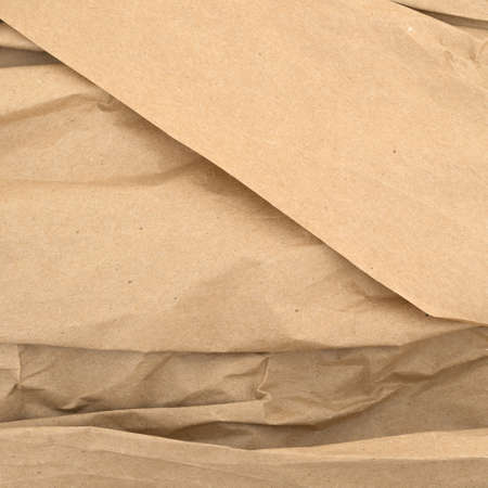 Used brown wrinkled packaging paper with creases.