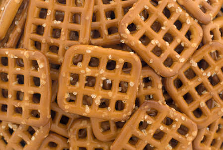 Top close view of brown salted waffle pretzels. Stock Photo