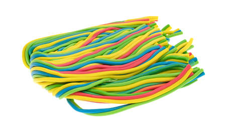 A large wad of string candy isolated on a white background.