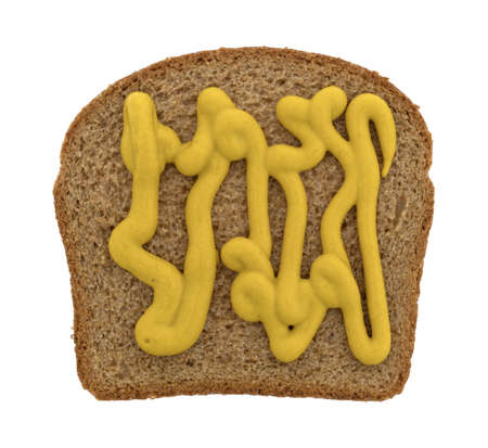 Top view of a piece of stone ground wheat bread with mustard isolated on a white background.
