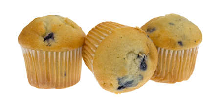 blueberry muffin: Three bite size blueberry muffins with one on its side isolated on a white background. Stock Photo