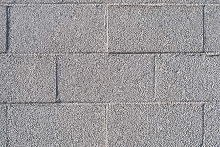 Close view of an old concrete block wall.