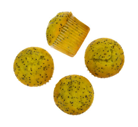 Top view of several bite size lemon poppy seed muffins with one on its side isolated on a white background. Stock Photo