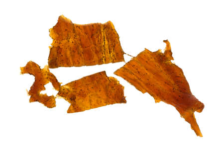 Top view of a three pieces of turkey jerky isolated on a white background.