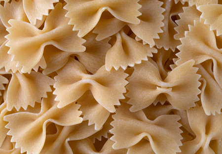 A close view of bow tie pasta illuminated with natural light.