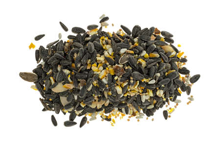 Top view of a pile of wild bird food with assorted seeds and peanuts isolated on a white background. Stockfoto