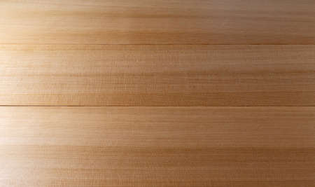 Top view of several western red cedar boards coated with several coats of polyurethane.