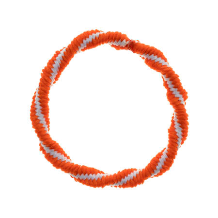 Top view of a colorful orange and white ponytail tie isolated on a white background. Stockfoto