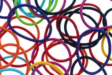 Top close view of a large group of elastic ponytail ties on a white background. Stockfoto
