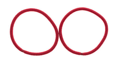 Top view of two red elastic ponytail ties on a white background.
