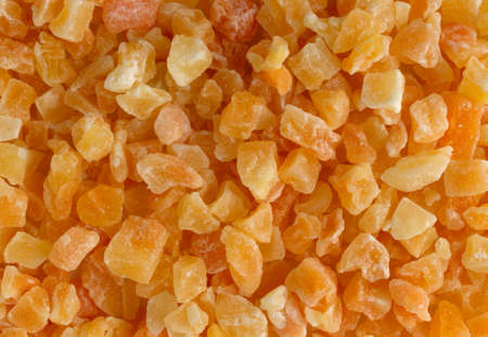Top close view of dried diced cantaloupe illuminated with window light.