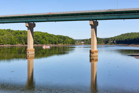 View of the bridge over the Passagassawakeag River in Belfast, Maine on a bright summer day.