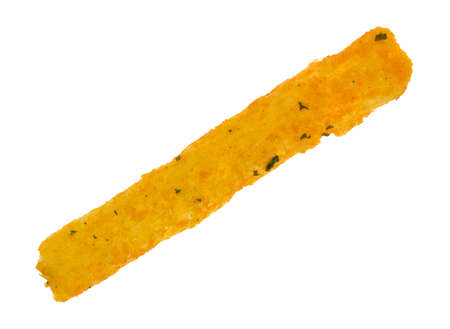 A single cheddar flavored snack in the shape of a french fry isolated on a white background. Stock Photo