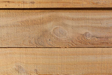 Close view of the surface of rough sawn lumber.