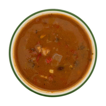Overhead view of a bowl of chicken tortilla soup isolated on a white background. Stock Photo