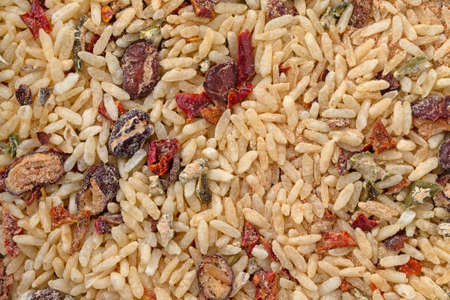 Close view of dry Mexican rice and beans mix illuminated with natural lighting.
