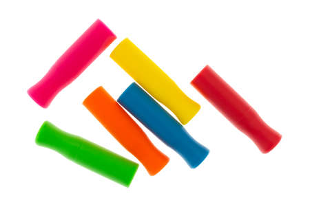 Assorted colors of silicone straw tips isolated on a white background.