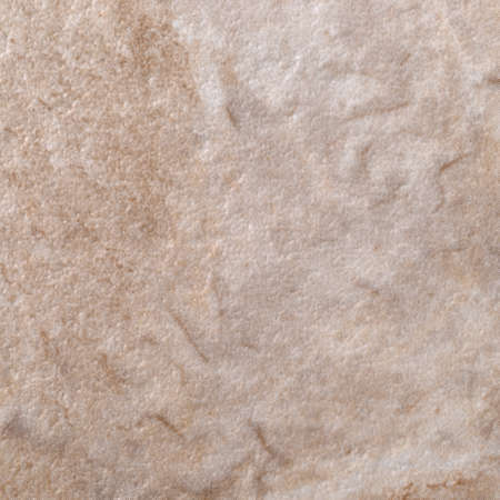Very close view of brown and tan vinyl floor tile.