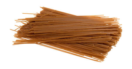 Side view of brown rice pasta isolated on a white background. Stock Photo