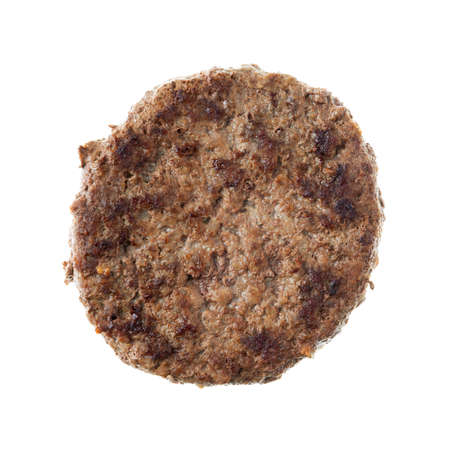 Single fried all beef lean hamburger patty isolated on a white background. 写真素材