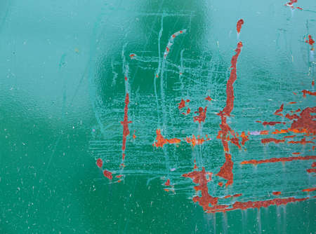 Close view of rusty painted green metal siding with large scratches. Banco de Imagens