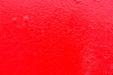Close view of garbage container painted bright red. Banco de Imagens