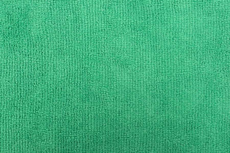 Very close view of a green microfiber cleaning cloth. Stock Photo