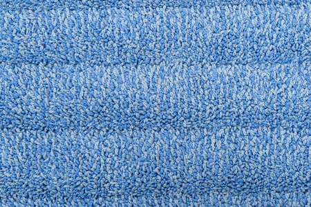 Very close view of a blue microfiber cleaning cloth.