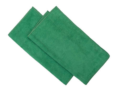 Top view of two folded green microfiber cleaning cloths isolated on a white background.