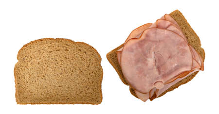 Top view of an open faced sandwich with thin sliced ham on wheat bread isolated on a white background. Imagens