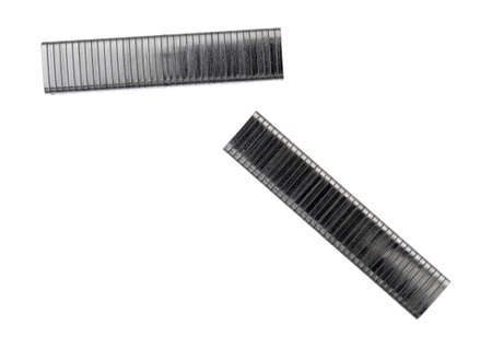 Two sections of industrial steel staples on a white background. 版權商用圖片